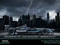 Hero graphic for Jaguar Land Rover North America, LLC to announce Jaguar's return to its racing heritage with their all-electric I-TYPE Formula E race car. The image was created with existing cityscape photography, while retouching included creating a storm effect from the clear sunset skyline, removal of existing vehicle, and addition of the I-TYPE and text, whilst remaining within strict corporate identity guidelines.